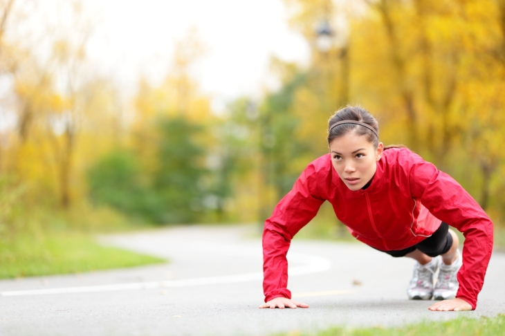 fitness-woman-doing-push-ups-during-outdoor-cross-training